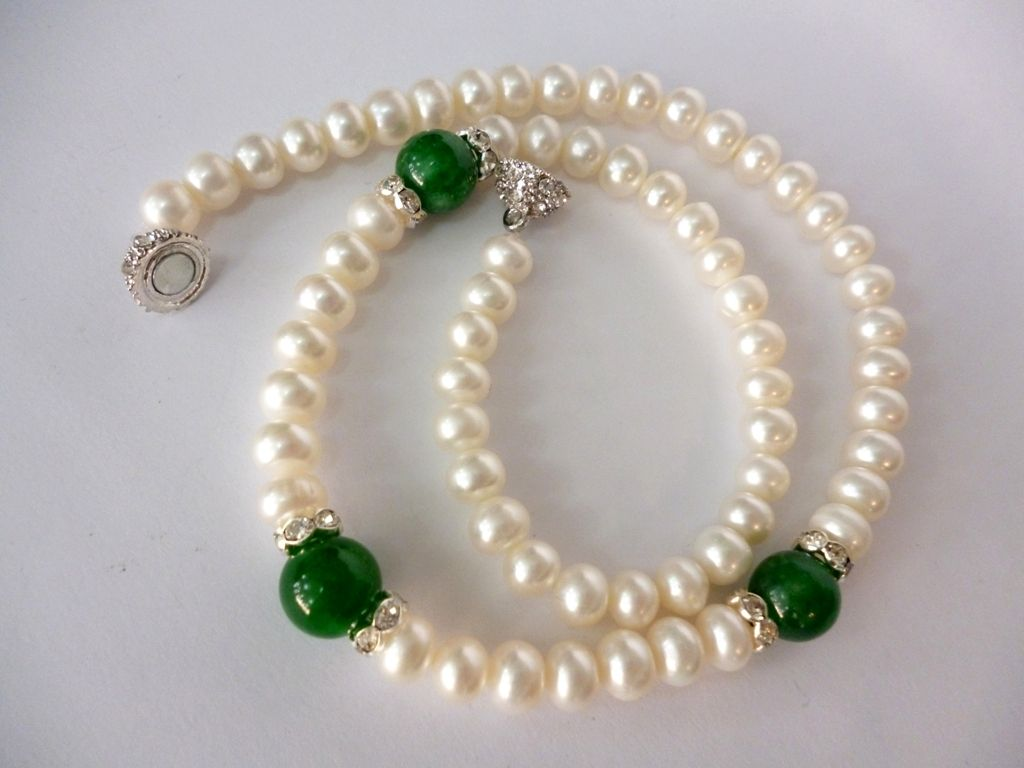 pearl necklace with featured jade gemstones